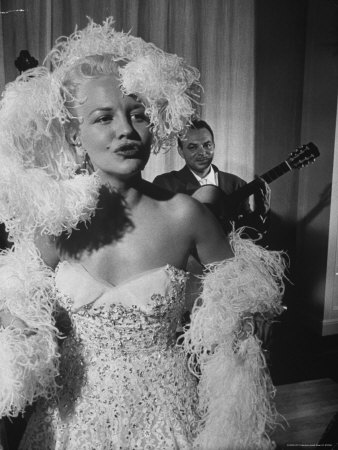 Pop Singer Peggy Lee, Wearing Feather Boa and Low Cut Gown at San Francisco's Fairmont Hotel