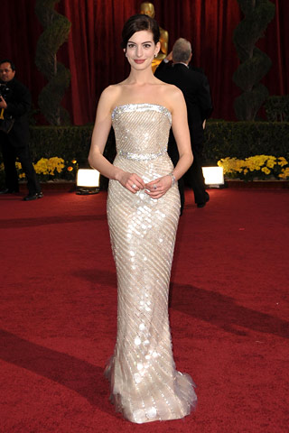 Anne Hathaway, in Armani Privé, with Cartier jewels. - style.com